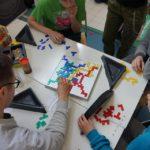 Children communicating over a geometric problem.